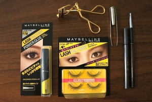 The tools you need. [From left to right]: Lash glue, eyelash curler, falsies, tweezers, liquid eyeliner, and an eyebrow brush
