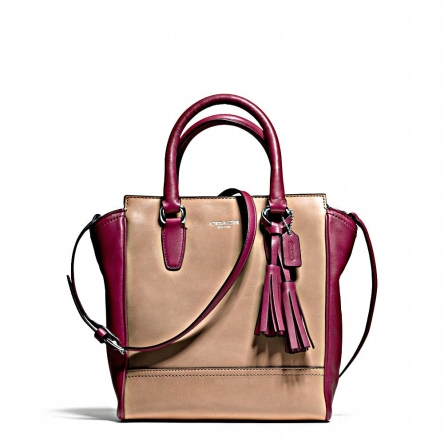 This two-tone bag, $570, is a versatile one that will take you from cubicle to club in a snap.