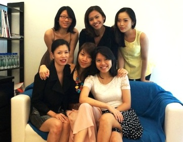 Ivy (seated, left) with her team at FoodNews PR.