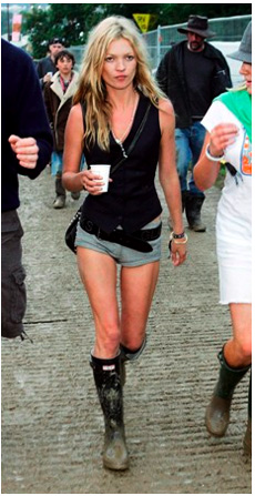 Kate Moss rocks out in Hunter boots, mud and all.