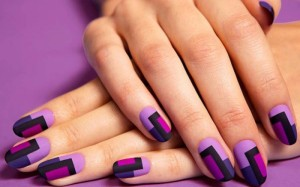 Try hints of orchid in graphic nail art.