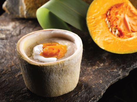 Steamed Mashed Taro with Pumpkin Puree served in Young Coconut