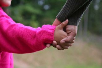 holding child hand