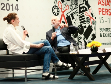 Colin McDowell (right), speaking with young London designer Thomas Tate at AFS 2014