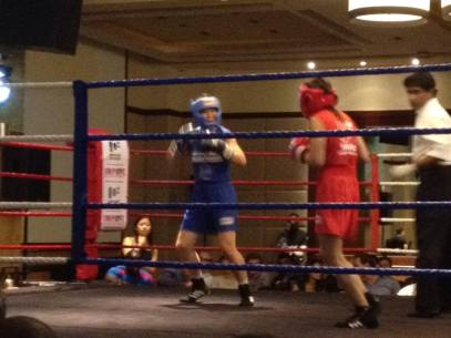Denise (in blue) at her first boxing match.