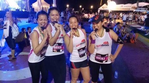 Lili (second from left) beams with pride after the Sundown Marathon.