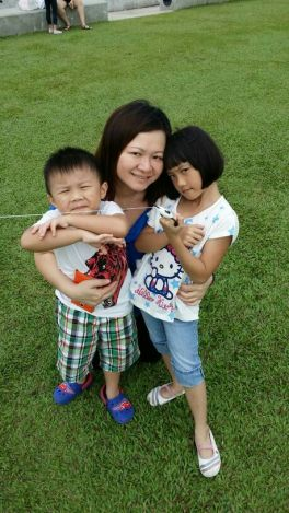 Claudia Foo with her children, Keivan (left) and Andrea.