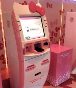 This machine checks you in AND prints out a specially designed Hello Kitty boarding pass for you.